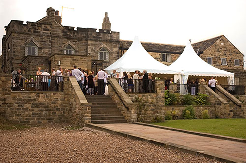 The Norfolk Arms marquees set up on the terrace with guests mingling